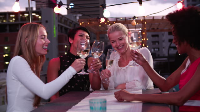 Group Of Female Friends Relaxing Together At Rooftop Bar video