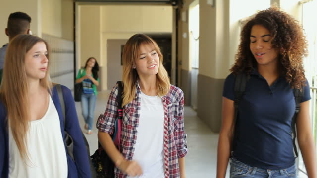 Group Of Female High School Students Walking Along Hallway video