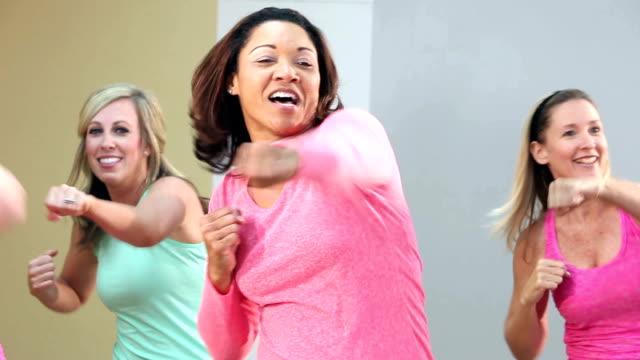 group of five women doing aerobics or dance routine - colpire con un pugno video stock e b–roll