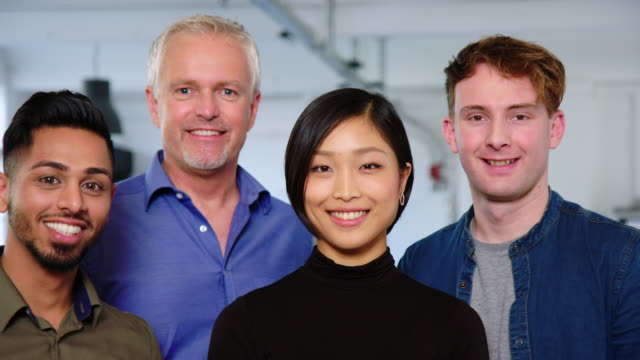 Group of four business professional in office