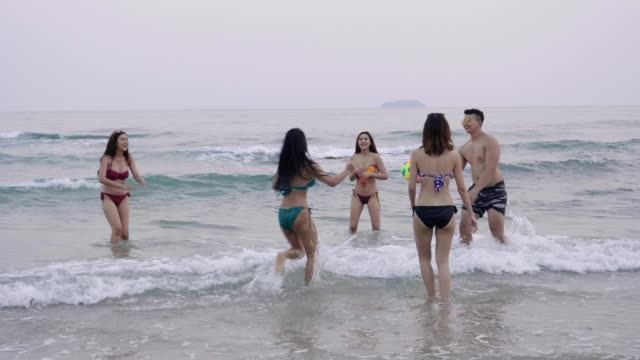 Group of friend enjoying on the beach