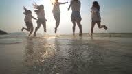 istock Group of Friend  having fun on the beach 1281287820