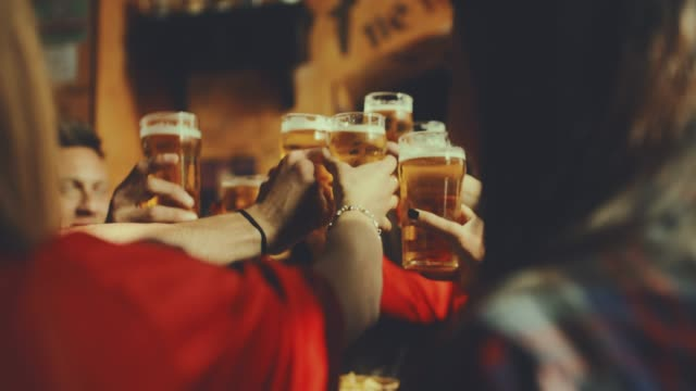 group of friends at the pub. shot in slow motion