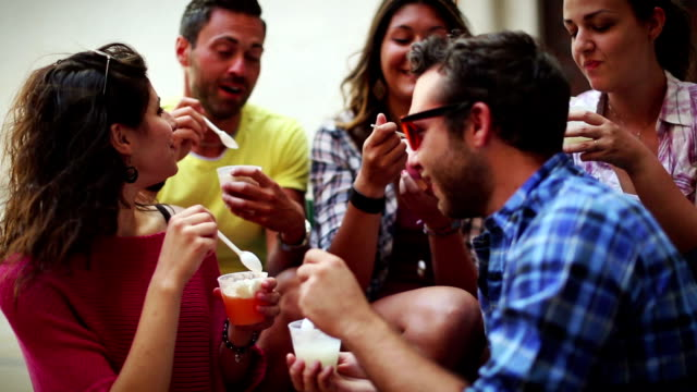 Group of friends eating icecreams video