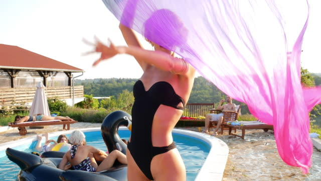 Group of friends enjoy summer on swimming pool Having fun with friends at the swimming pool in summer pool party stock videos & royalty-free footage
