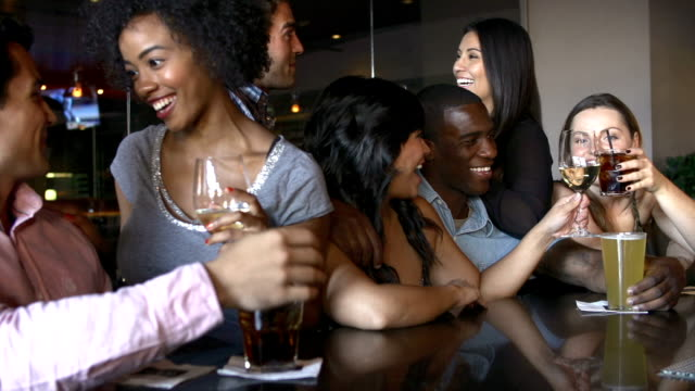 Group Of Friends Enjoying Drink At Bar Together video
