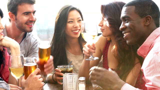 Group Of Friends Enjoying Drink At Outdoor Rooftop Bar video