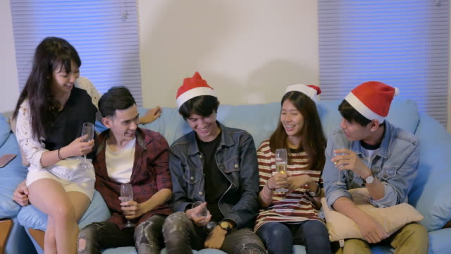 Group of friends happiness drinking beer on sofa for Christmas and new year party. video