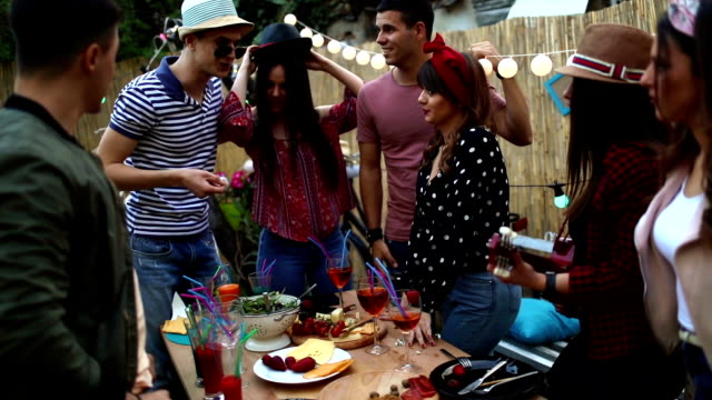 group of friends having dinner party in backyard - garden party stock videos and b-roll footage