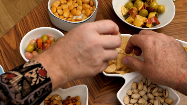 Group of friends having fun and eating snacks Group of friends having fun and eating snacks aperitif stock videos & royalty-free footage