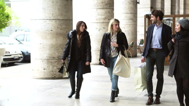 Group of friends in Italy during shopping video