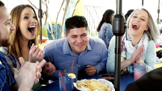 Group of friends in Tex-Mex restaurant laughing together video