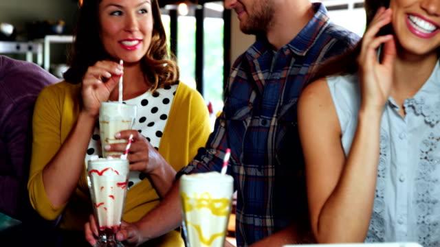 Group of friends interacting while having milkshakes video