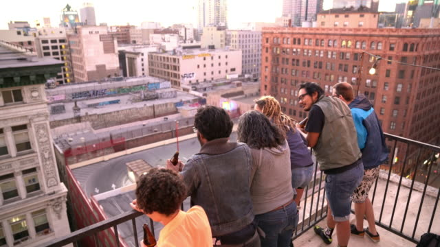 Group of friends leaning over a balcony in Downtown LA video