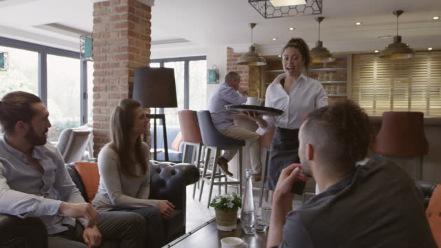 Group Of Friends Meeting For Coffee In Bar Shot On R3D video