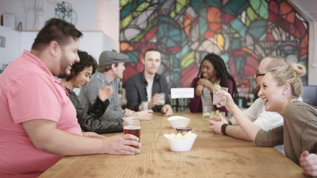 group of friends meeting for happy hour - bachelor party stock videos and b-roll footage