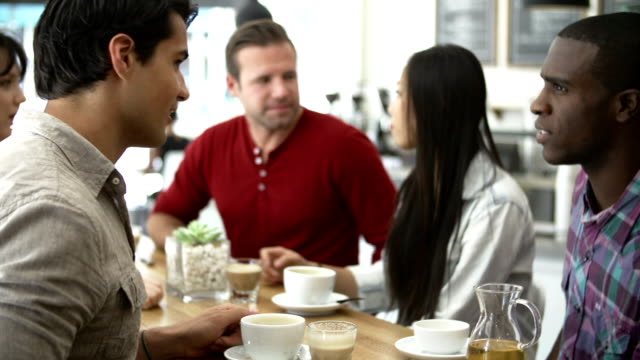 Group Of Friends Meeting In Coffee Shop video