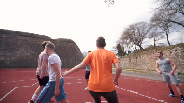 Group of friends playing amateur basketball Group of young adults playing amateur basketball outdoor practice drill stock videos & royalty-free footage