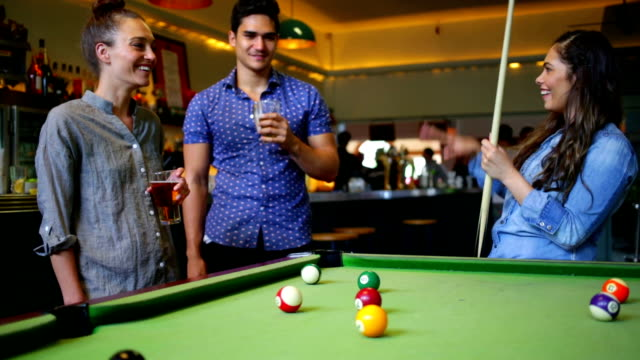 Group of Friends Playing Pool and Celebrating in an Australian Bar video