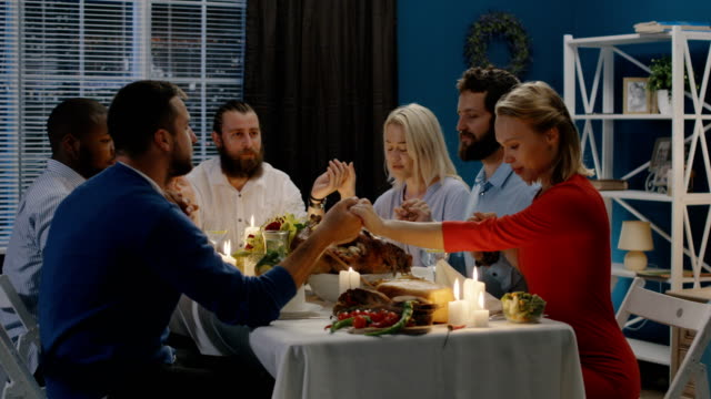 Group of friends praying on Thanksgiving day celebration video