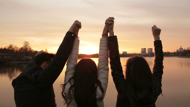 Group of friends saluting the challenge of a new day. video
