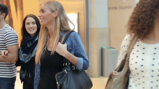Group Of Friends Shopping In Mall Together Group of friends walking through shopping mall together.Shot on Canon 5D MkII at frame rate of 25fps department store stock videos & royalty-free footage