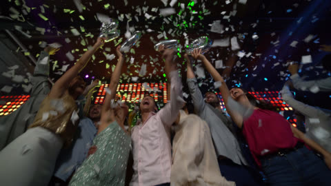 Group of friends shouting new year countdown for 2020 at a bar all excited hugging Group of friends shouting new year countdown for 2020 at a bar all excited hugging and celebrating happy new year stock videos & royalty-free footage