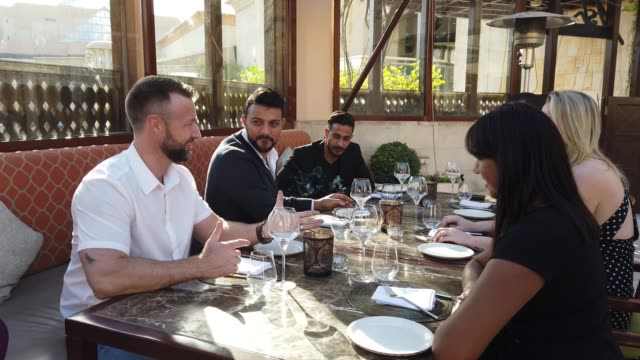 Group of friends spending time together at a fine dining restaurant