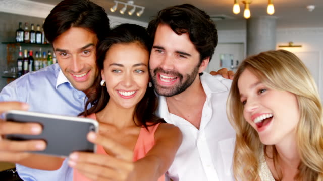 Group of friends taking selfie from smartphone video