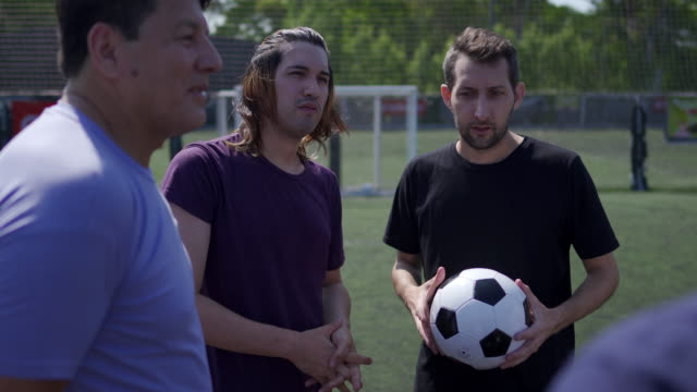 Group of friends talking about tactics before the start of the match Group of male friends talking about tactics before the start of the match pre game stock videos & royalty-free footage