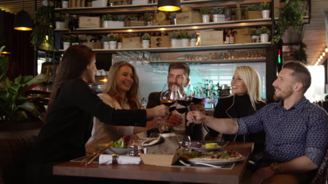 Group Of Friends Toasting In The Restaurant Slow Motion 4K