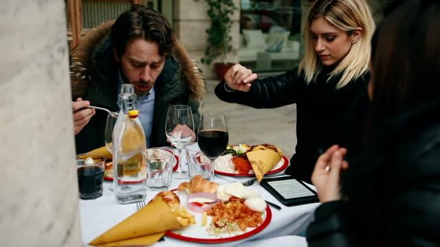 Group of friends together having brunch at restaurant video