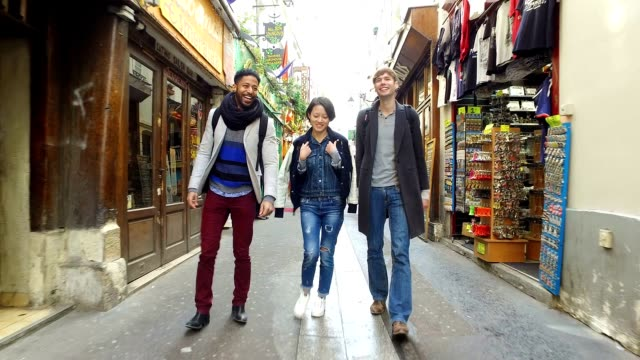 Group of friends visiting Paris, walking through the Latin Quarter (Quartier Latin)