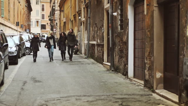 Group of friends walking in alley of Rome video