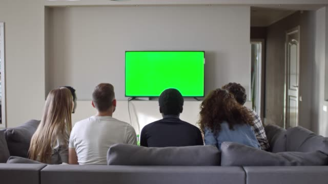 Group of Friends Watching Soccer on Chroma Key TV at Home video