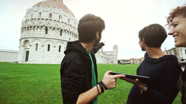 Group of friends with a digital guide of Piazza dei Miracoli video