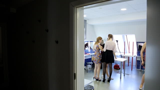 Group of girl prepares for going out in dressing room video