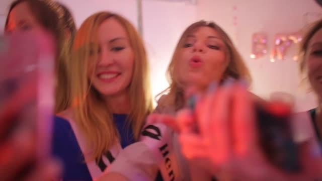 group of happy girls laughing, taking selfie