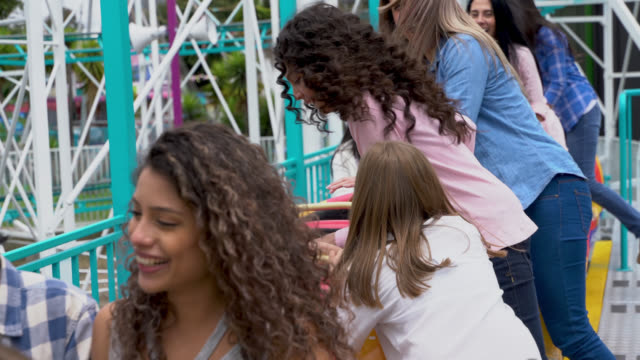 group of happy people getting on a rollercoaster ride at the amusement park - roller coaster stock videos & royalty-free footage