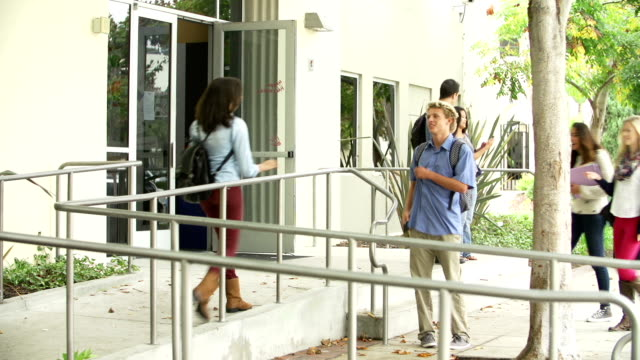 Group Of High School Students Standing Outside Building video
