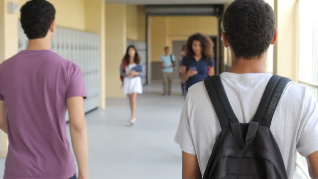 Group Of High School Students Walking Along Hallway video