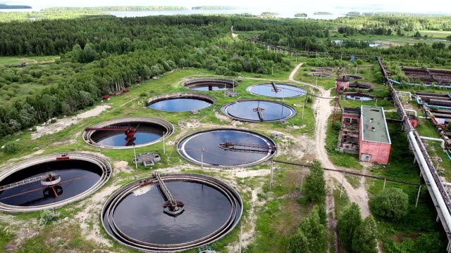 Group of huge circular sedimentation tanks with green environment video