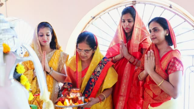 Group of Indian Women Praying at the Temple Devotion, Indian, Hindu, Celebration - A Group of Religious Women Performing Hindu Prayer Routines at a Temple indian culture stock videos & royalty-free footage