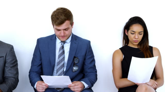 group of job candidates waiting for interview in office - unemployment stock videos & royalty-free footage