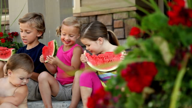 Group of kids sitting on porch eating watermelon video