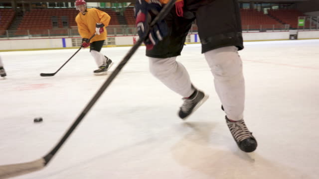 group of men playing ice hockey match in ice hockey rink. - hockey stock videos and b-roll footage