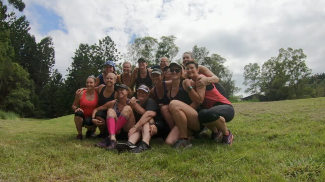 Group of Middle Aged Sports Women Gathering for a Group Photo After Competing in a Cross Country Fun Run video