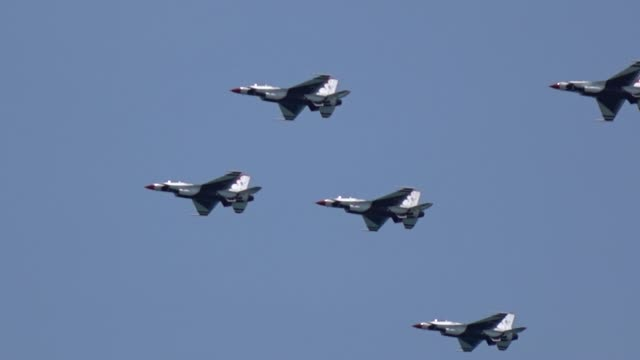 Group of military fighter planes flying over the coast