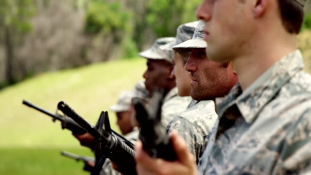 Group of military soldiers standing with rifles 4k video
