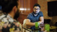 istock Group of millennial freelancers working together at home 1185754162